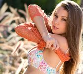 Amber Sym Takes Off Her Top In Warm Sunlight 3