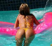 Christine Vinson - Fishnet Bikini and Pink Raft 5