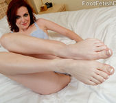 Emma Evins Gives a Footjob Blowjob and Exposes Her Sexy Feet 4