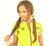 Maya, wearing a nice yellow sport suit 2