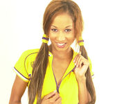 Maya, wearing a nice yellow sport suit 3