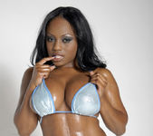 Smokin' Hot Ebony Beauty Jada Fire Lubes Up Her Big Tits 4