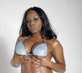 Smokin' Hot Ebony Beauty Jada Fire Lubes Up Her Big Tits 6