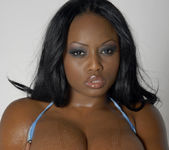 Smokin' Hot Ebony Beauty Jada Fire Lubes Up Her Big Tits 15