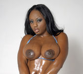 Smokin' Hot Ebony Beauty Jada Fire Lubes Up Her Big Tits 17