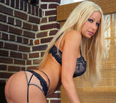 Gina Lynn gets naked and displays her unique curves 8
