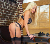 Gina Lynn gets naked and displays her unique curves 9