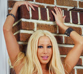 Gina Lynn gets naked and displays her unique curves 28