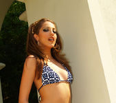 Jenna Haze Shows Us Some Skin In This Tropical Photoset 9