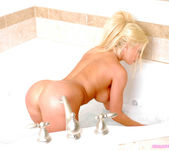 Blonde Babe Gina Lynn Strips And Takes A Sponge Bath 23