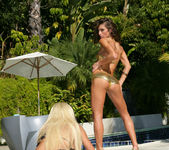 Gina Lynn Strikes A Pose With Her Latina Friend Naomi 3