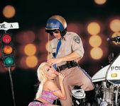 Busty blonde Gina Lynn sucks and fucks a cop 3