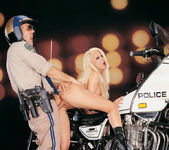 Busty blonde Gina Lynn sucks and fucks a cop 6