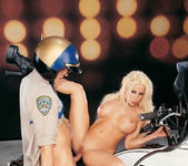 Busty blonde Gina Lynn sucks and fucks a cop 7
