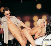 Busty blonde Gina Lynn sucks and fucks a cop 9