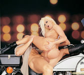 Busty blonde Gina Lynn sucks and fucks a cop 11