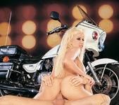 Busty blonde Gina Lynn sucks and fucks a cop 16
