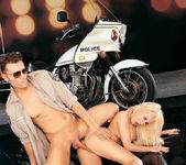 Busty blonde Gina Lynn sucks and fucks a cop 17