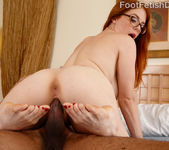 Hot Redhead Wraps Her Sexy Feet Around a Black Cock 12