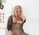 Stevie Lix - bodystocking milf with a whip 10