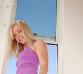 Horny petite Kara peels up her lavander dress 2