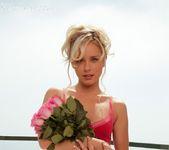 Ravishing pinup Kara Duhe wearing her skimpy, pink dress 3