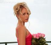Ravishing pinup Kara Duhe wearing her skimpy, pink dress 12