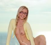 Nerdy Kara wearing her hot yellow hoody strips her panties 15