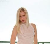 Ravishing teen Kara wearing her sultry, white stockings 9