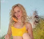 Captivating model Kara peels off her yellow top flashing 5