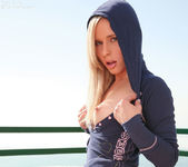 Hot sensual Kara in her blue hoodie strips her panties 7