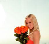 Classy flirt Kara naughtily lifts her tight, orange dress 2