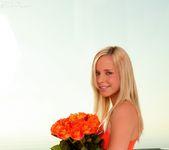 Classy flirt Kara naughtily lifts her tight, orange dress 3