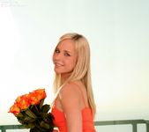 Classy flirt Kara naughtily lifts her tight, orange dress 8