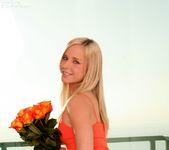 Classy flirt Kara naughtily lifts her tight, orange dress 9