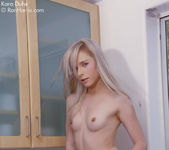 Gorgeous Kara in the kitchen nude eating a tangerine 12