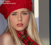 Poshy hot Kara wearing a sexy scarf in a chair posing 9