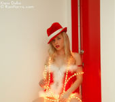 Lustful Kara in a christmas outfit wrapped with lights 2