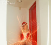 Lustful Kara in a christmas outfit wrapped with lights 3
