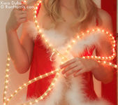 Lustful Kara in a christmas outfit wrapped with lights 4