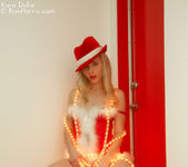 Lustful Kara in a christmas outfit wrapped with lights 9