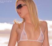 Kara stripteasing on the terrace pulling her bra 3