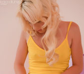 Kara Duhe in yellow tops and pink shawl spreading 4