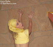 Stunning chick Kara Duhe in her funky, yellow outfit 8