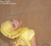 Stunning chick Kara Duhe in her funky, yellow outfit 9
