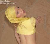 Stunning chick Kara Duhe in her funky, yellow outfit 10