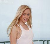 Teen goddess Kara Duhe in her sheer, white dress 9