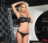 Alexa Grace teasing in her black lingerie in the lounge 9