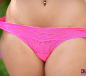 Charley teasing in the garden in pink thong 14