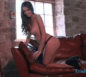Emelia Paige teasing in black lingerie on the sofa 15